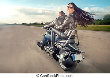 Man and woman riding on motorcycle - Biker Man and woman...
