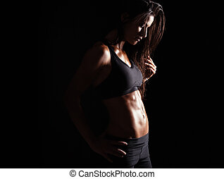Female in sports clothing relaxing after workout - Image of...