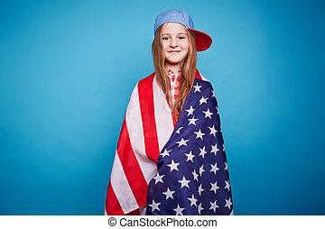 American girl - Cute girl in cap wrapped in American flag...