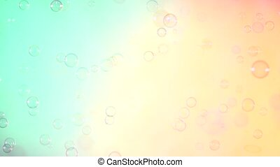 Blue and clear soap bubbles on turquoise and pink,...