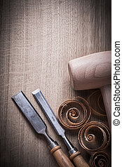 Wooden mallet shavings carpenterâ??s firmer chisels on wood surf