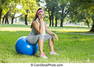 Fitness Healthy Smiling Young Woman Resting on Pilates Ball...