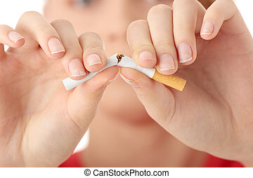 End of smoking - Young caucasian woman quiting smoking...