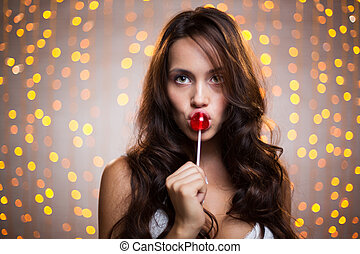 Teasing - Pretty long-haired brunette with lollipop looking...