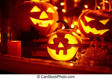Helloween lanterns - Eerie pumpkins burning in window