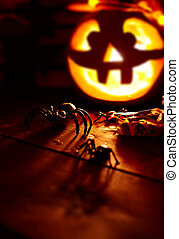 Halloween spiders - Creepy spiders on background of burning...