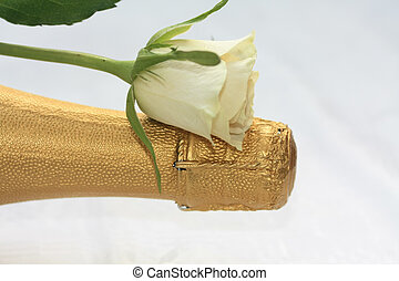 White rose on a champagne bottle - A white rose on a...