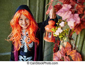 Happy Halloween girl - Cheerful girl in Halloween attire...