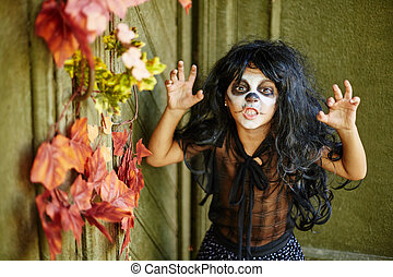Fury - Cute child in wig and Halloween attire looking at...