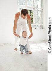 young father with his nine months old son at home - Young...