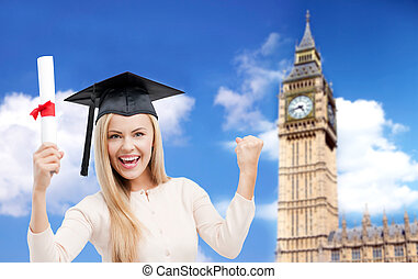 student in trencher cap with diploma over big ben -...
