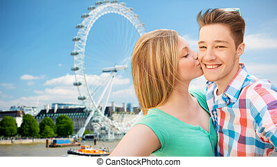 happy couple taking selfie over london - travel, vacation,...