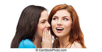 one girl telling another secret - friendship, happiness and...