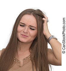 Worried woman - A woman looks worried with her hand in her...