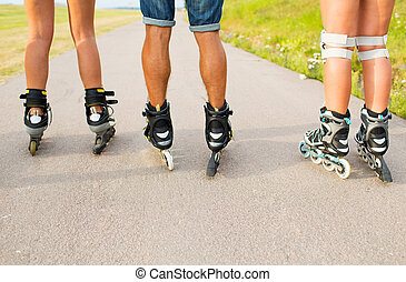 close up of legs in rollerskates skating on road - leisure,...