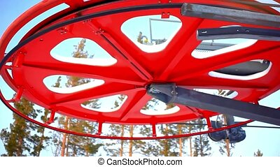 Ski lift , drag lift. Twisting mechanism lifts around