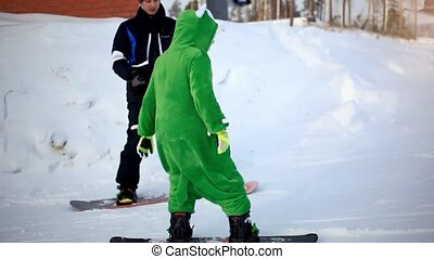 Snowboarder dressed kigurumi on piste in high mountains -...