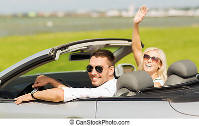 happy man and woman driving in cabriolet car - transport,...