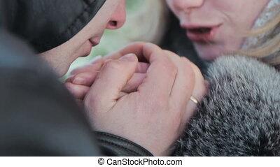 boyfriend warms hands sweetheart, frozen in the cold, HD