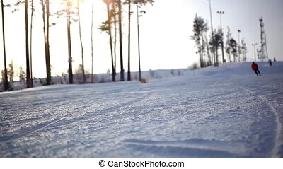 Free-rider blurred skiers moving down in snow powder at...