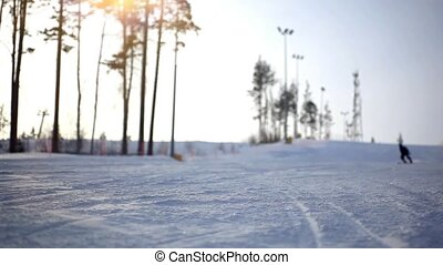 Silhouette Free-rider skier moving down in snow powder at...