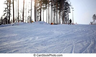Free-rider blurred skier moving down in snow powder at...