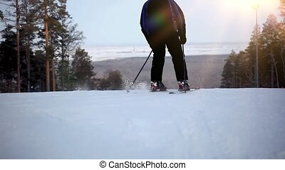skier ride the mountain and disappear from the horizon
