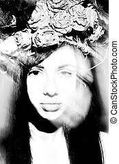 Portrait of fashion model with flowers in hair