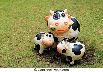 smile cow statue with cement decoration outdoor