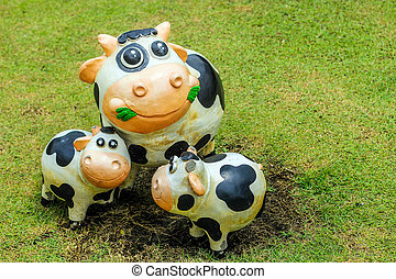smile cow statue with cement decoration outdoor - close up...