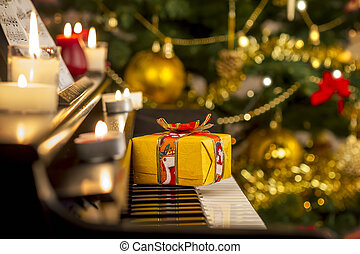 Christmas gift on piano. Christmas decoration with gift on...
