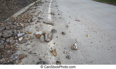 Curve in Road Sign Crash Tilt Up - Tilt up shot of rocks on...