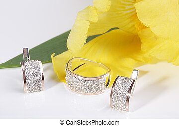 Jewelry - Beautiful gold ring and earrings on a yellow...