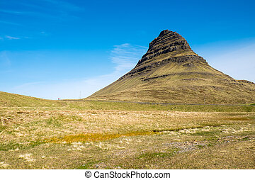 Mount Kirkjufell in Iceland - Mount Kirkjufell on the...