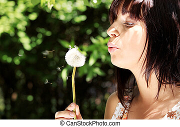 Girl in park with a dandelion