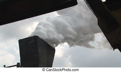 Tower to extinguish coal - steam comes out of the tower to...