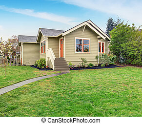 Lovely American home with grass filled lawn.