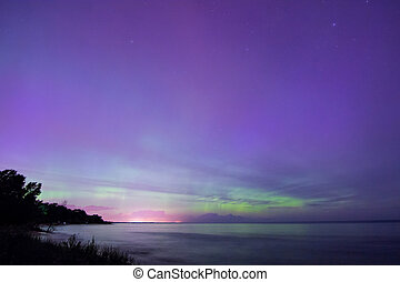 Northern Lights, Aurora Borealis displaying over Lake...