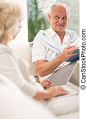 Senior woman and man - Senior woman with laptop and man with...