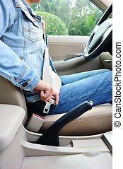 woman driver buckle up seatbelt