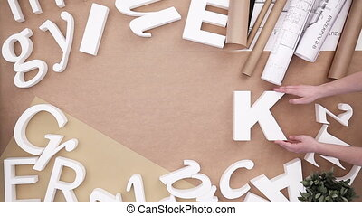 Work - people building word from white letters