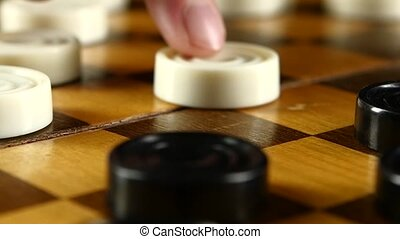 Two persons continue playing on checker board, hit, slow motion, close up
