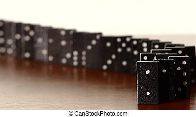 Domino, isolated on white, dynamic change of focus, slow motion