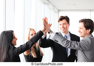 Business people giving high five - Happy business people...