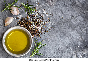 Food Background Olive Oil Salt Peppercorns Rosemary and Garlic over Slate