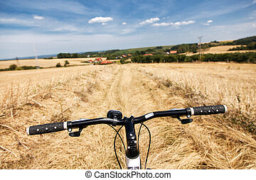Riding a bicycle in the fields