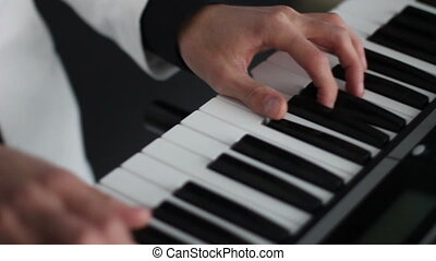 young man pianist