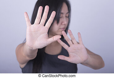 hand - woman showing her denial with NO on her hand