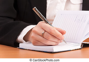 Business woman writing in notebook - Office lady writing...