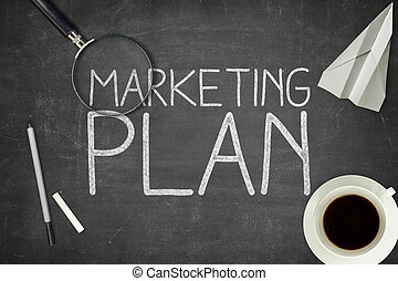 Marketing plan concept on black blackboard with coffee cupt...